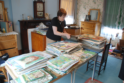 Going through artwork in Aunt Katherines Studio. Photo by C. Ashley Spencer