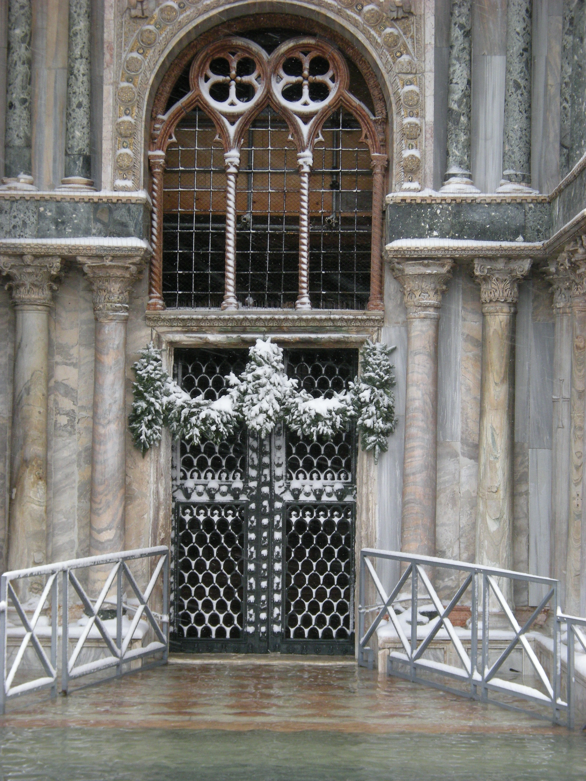 Venetian Church Doors with Snow. Photo © by Pietro deScarpis