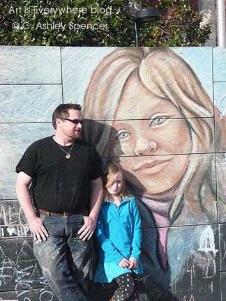 Sam Welty with Lily & his chalk portrait. Photo by Piers Spencer