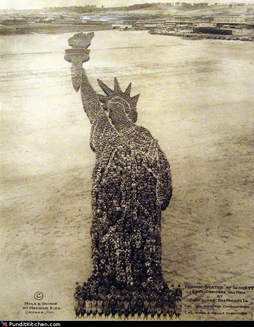human statue of liberty via Pundit Kitchen, as seen on Art Is Everywhere