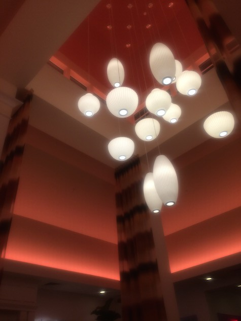 Hilton Vestibule Lights surrounded by ever changing florescent lighting on Art Is Everywhere