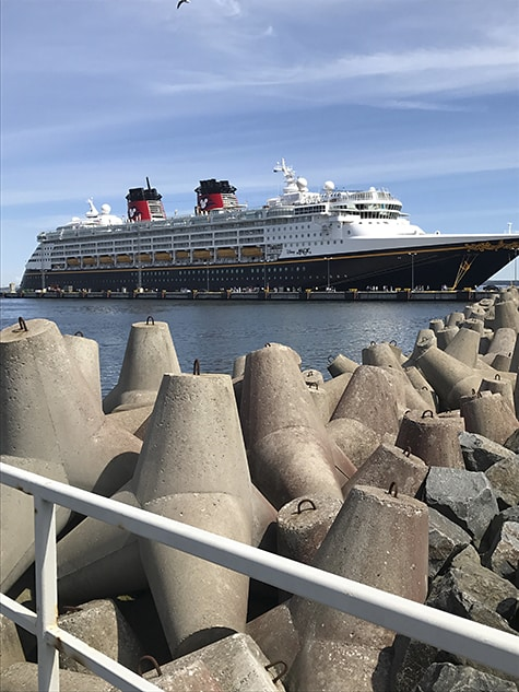 Concrete barriers welcome the Walt Disney cruise ship on AIE