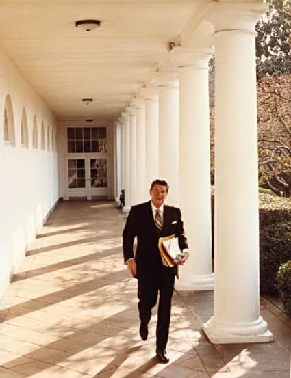 President Reagan walking White House West Wing Corridor via White House Museum on AIE