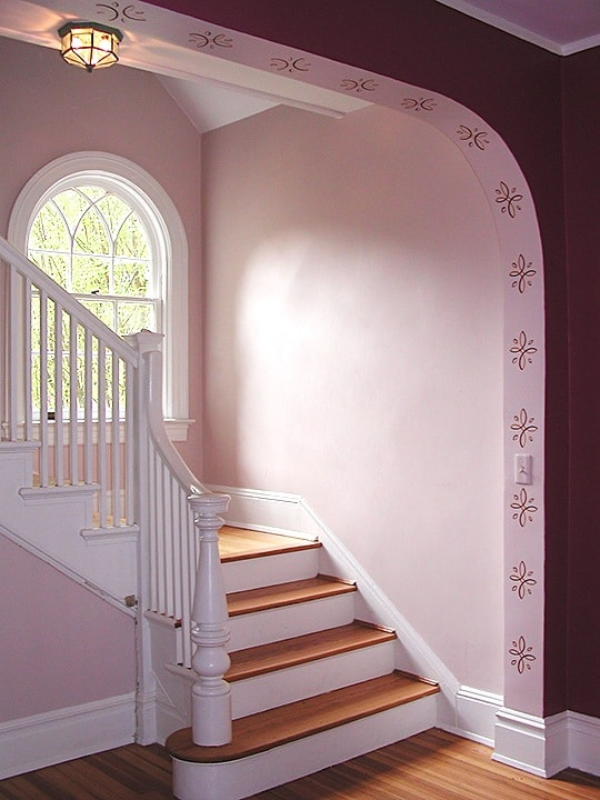 Arch stencil stairwell by Ashley Spencer