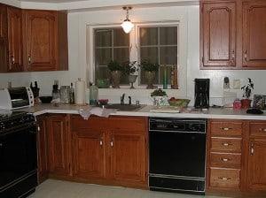 Before whitewashing kitchen cabinets -sink side