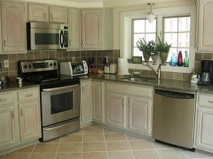 After whitewashing kitchen cabinets -refrig side by Ashley Spencer
