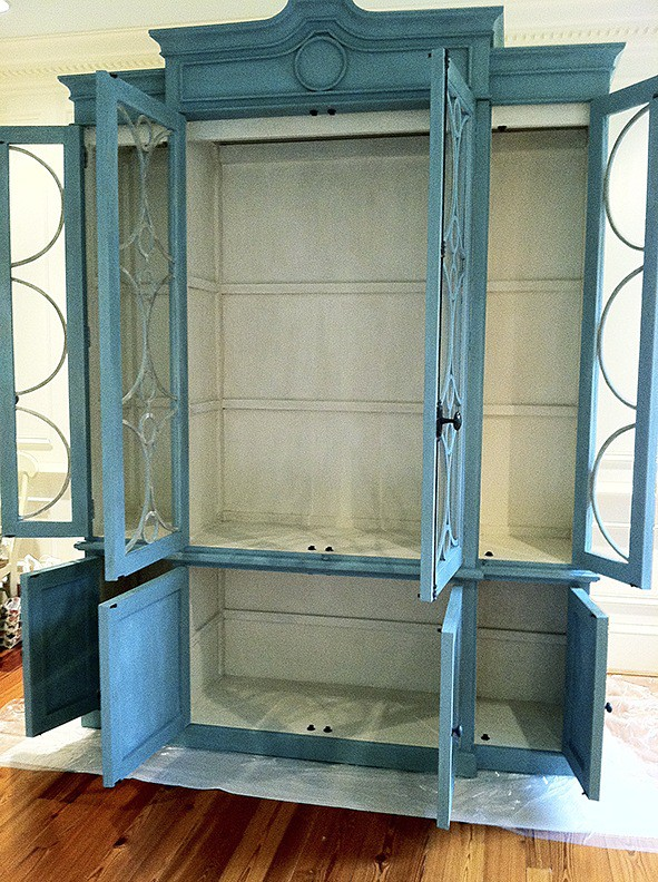 Armoire after interior has been painted with decorative treatment