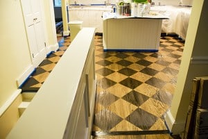 Remodeled Kitchen Floors with New Stained Diamonds painted by Ashley Spencer