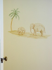Elephants behind door in tropical nursery mural painted by Ashley Spencer
