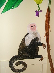 Monkey close up in tropical nursery mural painted by Ashley Spencer