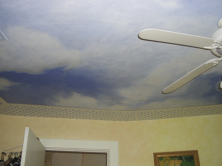 Bedroom ceiling sky in cloud mural painted by Ashley Spencer