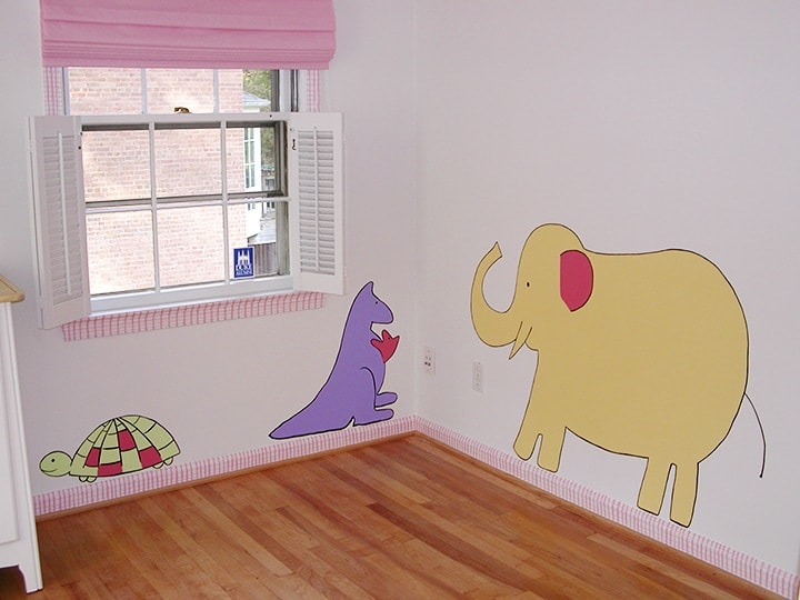 Nursery corner with hand-painted animals on ashley-spencer.com