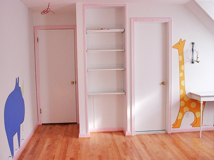 Nursery After with Animals and Hand Painted Plaid Molding on ashley-spencer.com