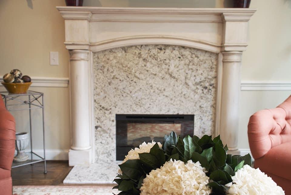 Fireplace Detail with Flowers via ashley-spencer.com