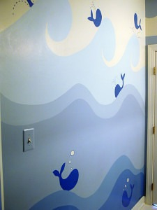 Whales sail the waves in this full feature wall mural painted by C. Ashley Spencer